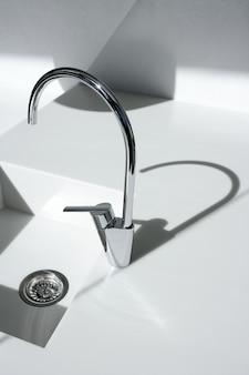 White modern kitchen detail, faucet and sink