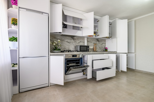 White modern kitchen interior some drawers pulled out