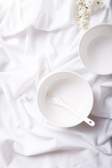 White monochrome food background concept for design menu restaurant or cafe. ceramic plates and dishes.