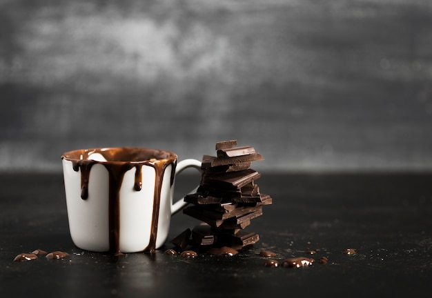 White mug filled with chocolate and copy space