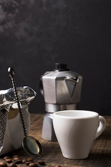 White mug for hot coffee and grinder