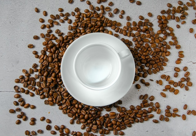 White mug and saucer for hot drinks on a neutral background