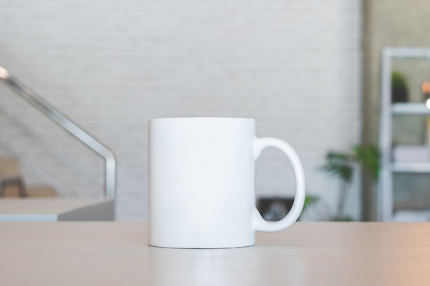 White mug on table and modern room background