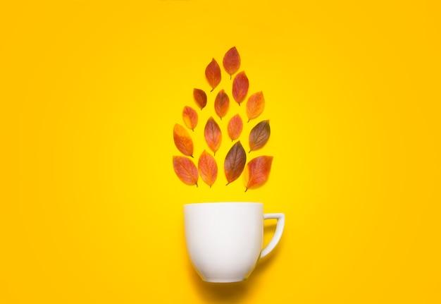 White mug with autumn leaves