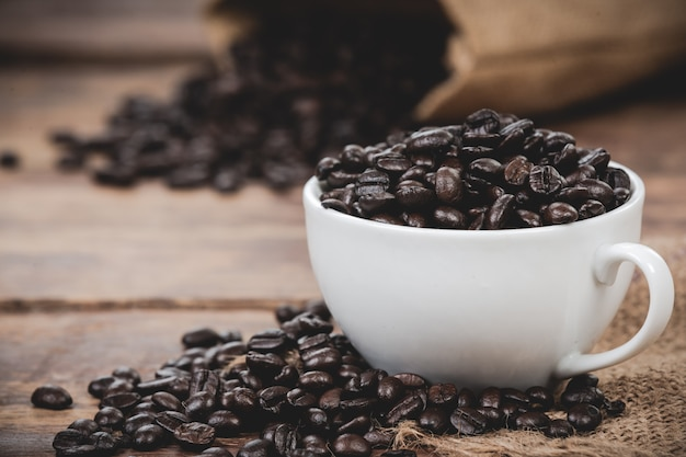 White mug with coffee beans