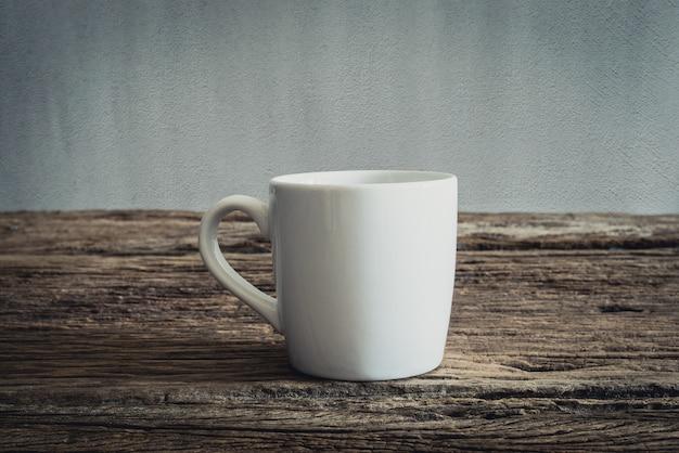 White mug on wooden tabletop