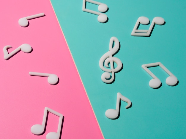 White musical notes on bright colorful background