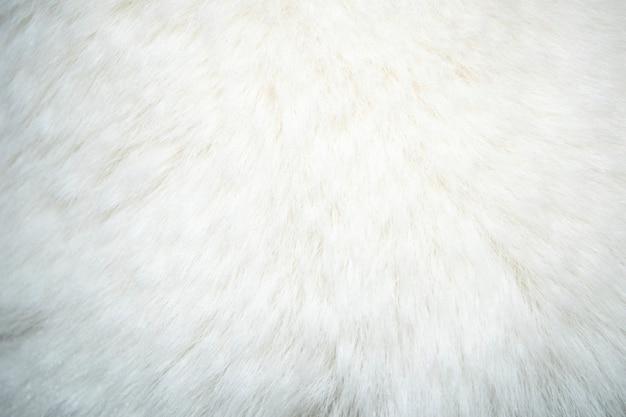 白い自然な毛皮の背景またはテクスチャ