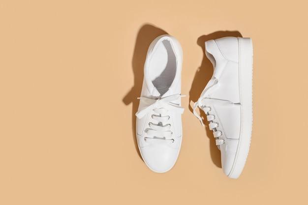 White new female gumshoes on beige