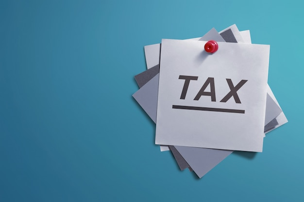White note paper and written tax for reminder