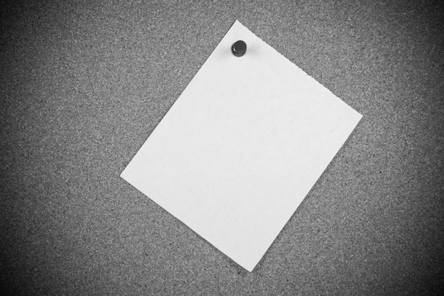 White note papers on cork board  background.