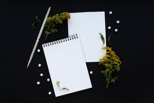 White notebook mockup template on black background with magical mysterious mood