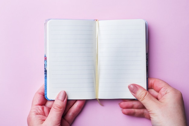 White notebook with clean sheets.