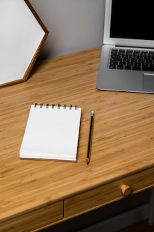 White notebook on wooden table