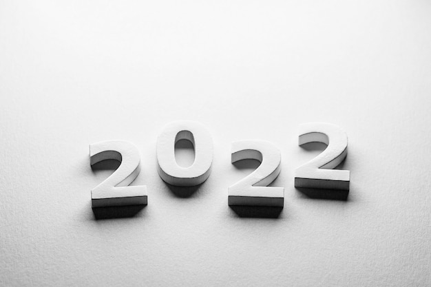 White numbers 2022 on a white background minimalism postcard 2022 papercut numbers 2022 winter