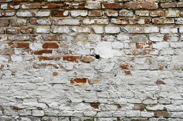 White old cracked brick wall