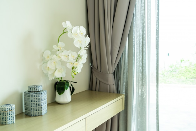 White orchid in vase decoration in a room