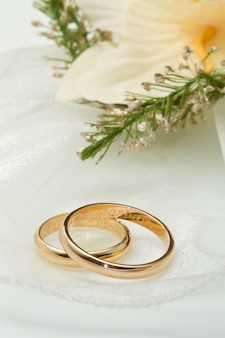 White orchids and wedding rings