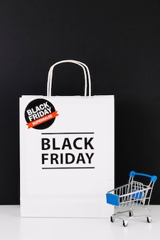 White packet with inscription and shopping trolley