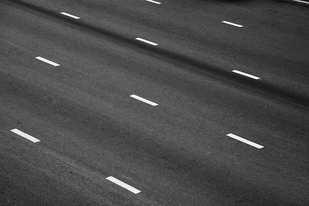 White paint line on black asphalt