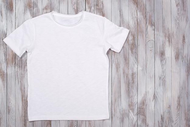 White paint tshirt with copy space tshirt mockup flat lay