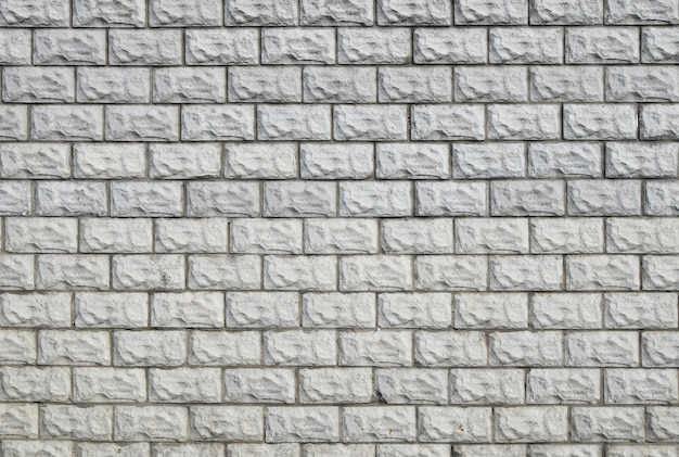 White painted brick tile wall background texture pattern; close up