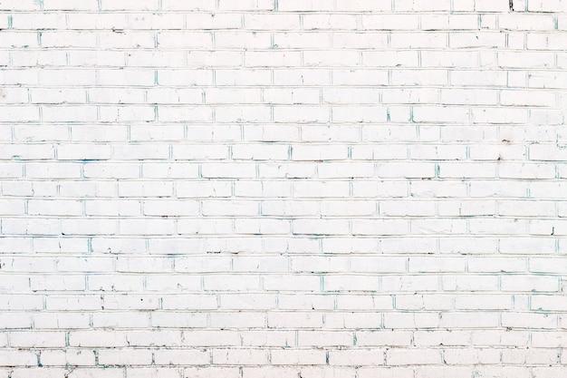 Белая окрашенная кирпичная стена фон