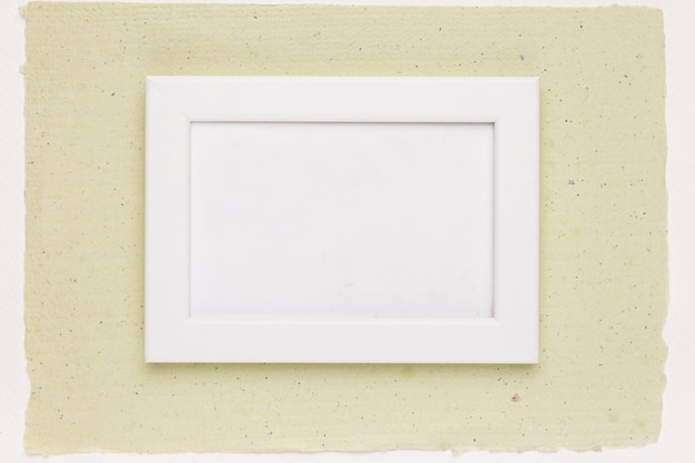 White painted frame on mint green paper