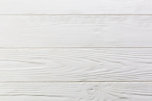 White painted rough wooden surface