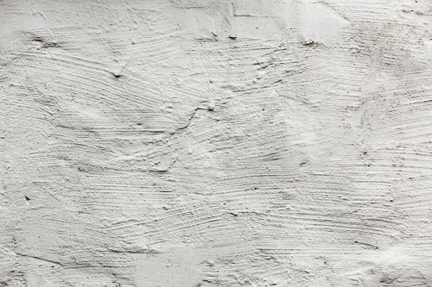 White painted wall texture with cracks