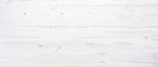 White painted wooden desk background tabletop  light blank rustic wood texture timber board surface empty table plank header with copy space, top view
