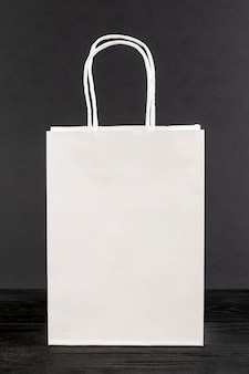 White paper bag on black background
