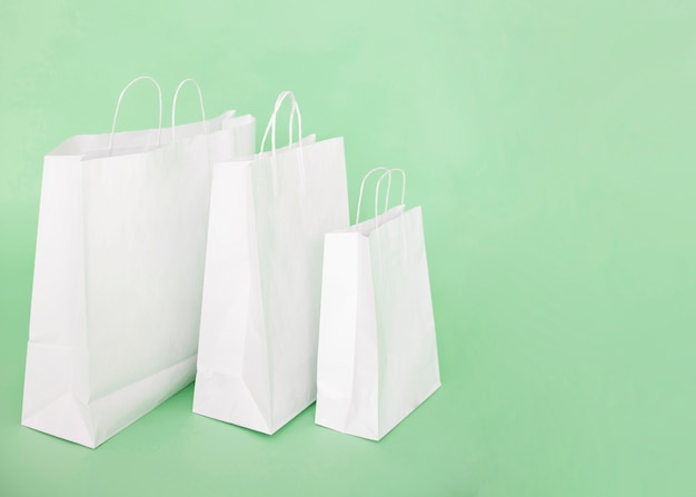 White paper bags on light blue background