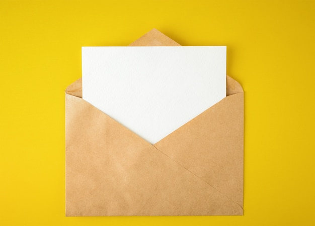 White paper card in an envelope on yellow background