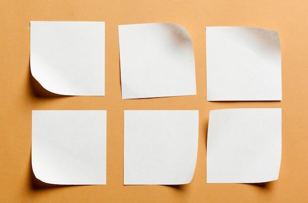 White paper card on orange surface