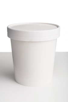 White paper cup with lid on white table isolated on white space