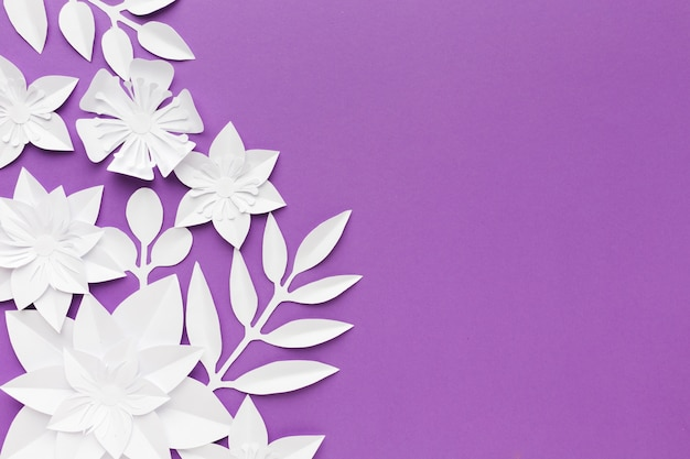 White paper flowers on purple background