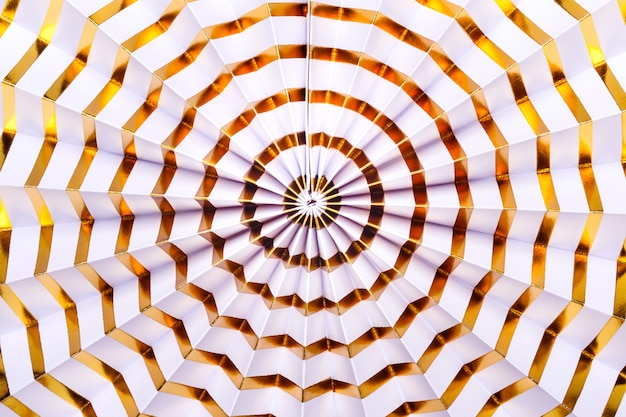 White paper gold striped decor. festive abstract background.
