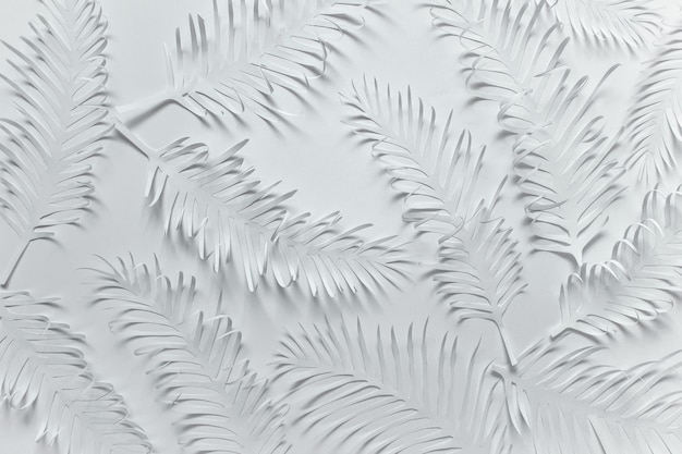 White paper made pattern with tropical leaves