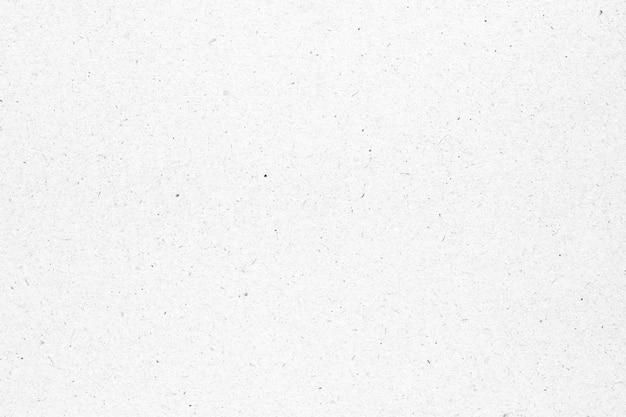 Текстура белой бумаги или картона с черным фоном пятна.