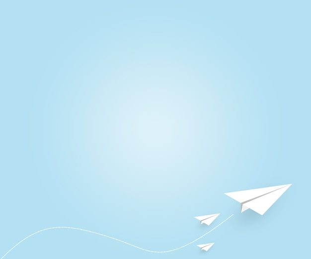 White paper plane flying on blue sky background