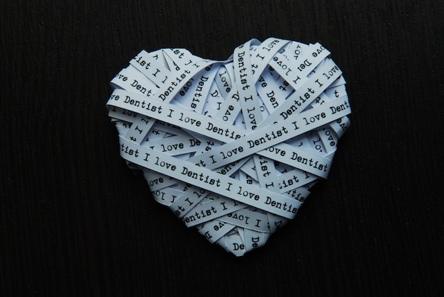 White paper ribbon in heart shape showed text