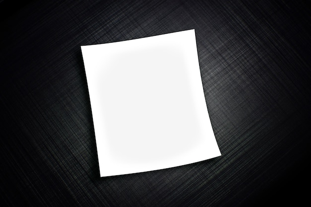 White paper sheet realistic on black metal striped textured background