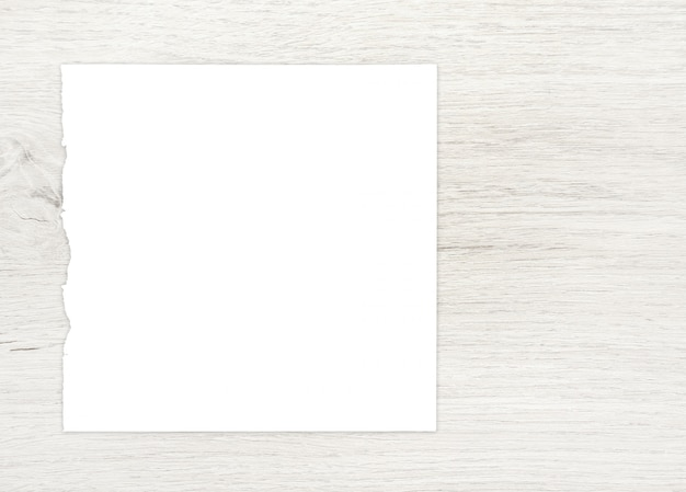 White paper sheet on wood for ackground.