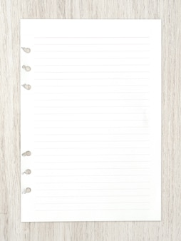 White paper sheet on wood for background.