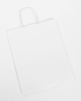 White paper shopping bag on white background