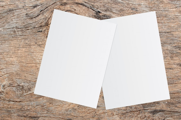 White paper and space for text on old wooden background