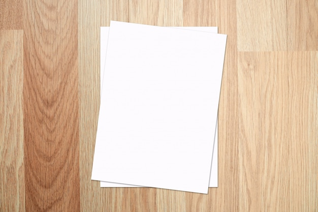 White paper and space for text on old wooden texture background. top view