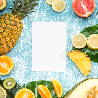 White paper surrounded by exotic fruits
