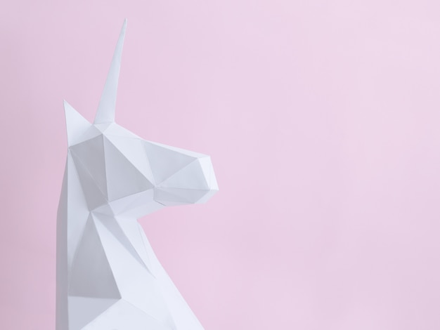 White paper unicorn on a pink background